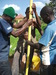 Thumb_technician_with_some_beneficiaries_inserting_pipes_in_the_bore_hole_at_st.teresa