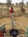 Thumb_samburu_child_pumping_water_into_basin__2_