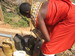 Thumb_samburu_woman_transfering_water_into_jerry_can