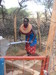Thumb_samburu_woman_pumping_water