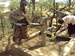 Thumb_samburu_child_jumping_in_order_to_pump_the_well