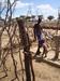 Thumb_samburu_man_at_the_well_with_kid__2_
