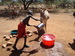 Thumb_samburu_child_pouring_water_for_donkey